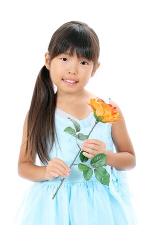 Photo of little asian girl holding rose flower Stock Photo - 16334296