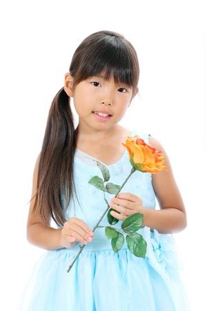 Photo of little asian girl holding rose flower Stock Photo - 16334298