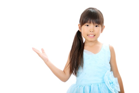 little asian girl rise hand showing blank sign Stock Photo - 16334286