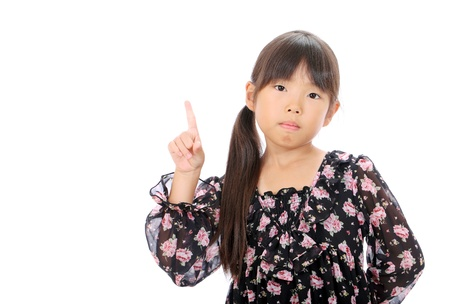 Little asian girl rise hand and pointing Stock Photo - 16334290