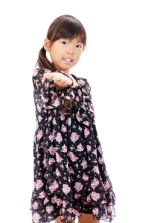 Smiling little asian girl hand showing Stock Photo - 16334293