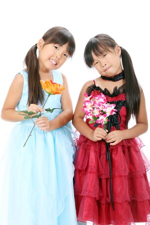 Two little asian girls holding flower Stock Photo - 16334303