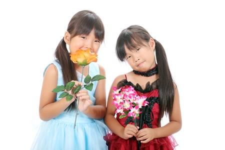 Two little asian girls holding flower Stock Photo - 16334294