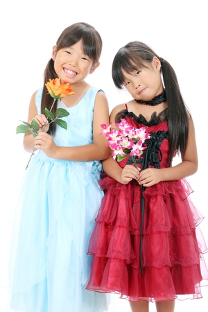 Two little asian girls holding flower photo