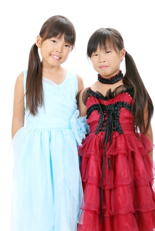 Two little asian girls wearing dress photo