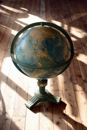antique world globe stands on the floor Stock Photo - 17001097