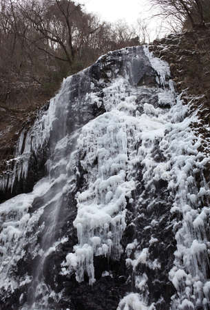 Waterfall on a mountain river in winter  Stock Photo - 17459122