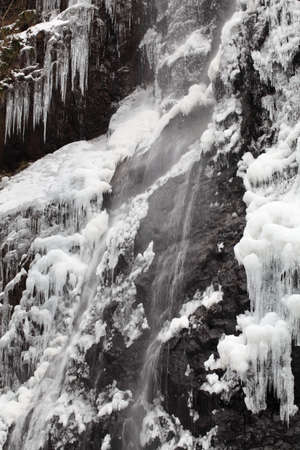 Waterfall on a mountain river in winter Stock Photo - 17459117