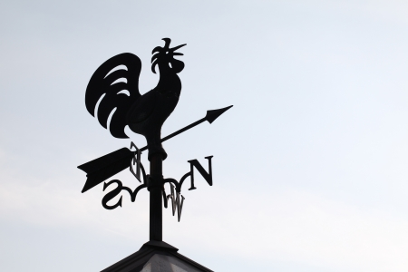 Weathercock silhouetted against a sky  photo