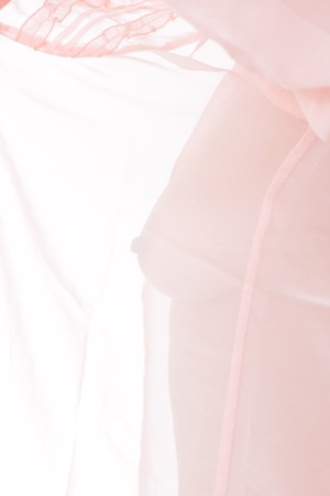 Body of a naked woman through the transparent fabric Stock Photo - 17471271