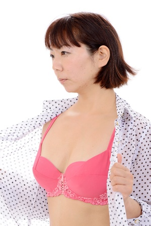 Sexy young asian woman in open shirt and bra photo
