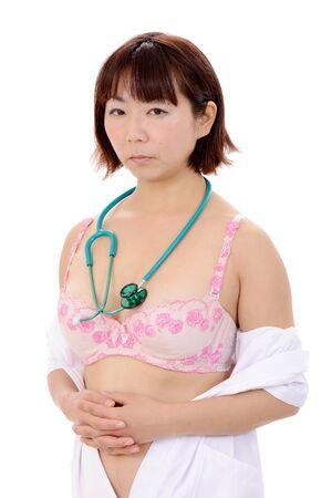 Portrait of sexy asian female nurse with stethoscope Stock Photo - 17544594