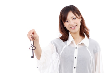 young asian woman holding keyring in her hand  photo