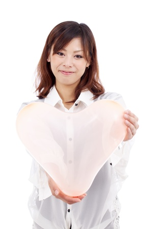 young asian girl holding a pink heart shaped balloon photo