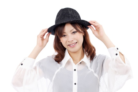 Happy young asian girl wearing hat on white background  photo