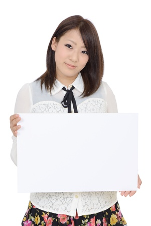 Young asian woman holding blank board in front photo