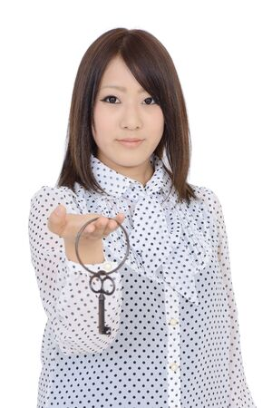 Young asian woman holding a antique key in her hand photo