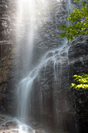 waterfall falling down rocks in the forest  photo