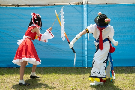Kagawa, Japan - May 3th, 2013 - Japanese young woman and man who participated in costume play rally of the outdoors, at Marugame-Jou Park.