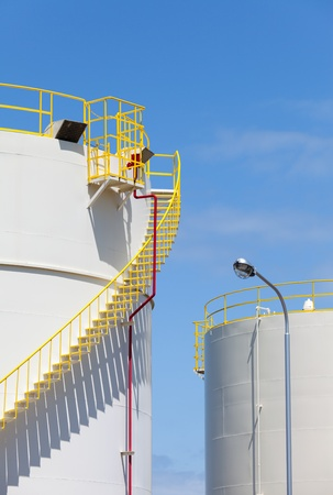 Industrial storage tank against a blue sky photo