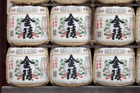hachimangu: KOTOHIRA, JAPAN - JULY 7: Sake barrels at Konpira Hachiman-gu Shrine at July 7, 2013 in Kotohira, Japan. Old Japanese custom is to donate sake to the temples and shrines as offering for the Gods.