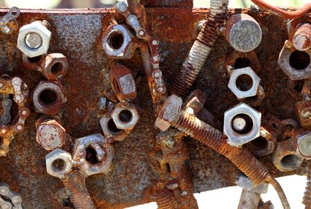Rusty bolts and nuts on an old machinery  photo
