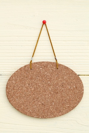 Blank cork board hang on the wall background photo