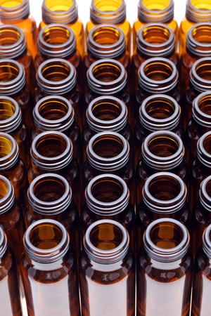 rows of brown glass bottles photo