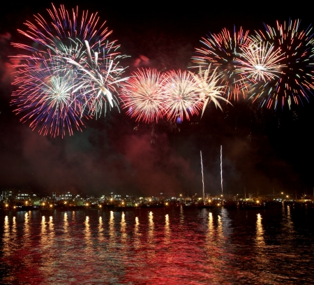 japan sky: beauty of the fireworks reflect on sea water