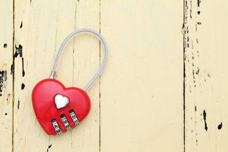 hart shaped: Red hart shaped padlock on wooden background