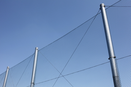 linkage: metal wire fence with blue sky in background