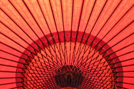 Design underneath the red Japanese umbrella  photo