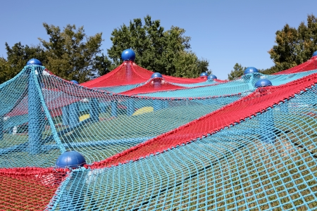 Blue and red spider net construction on kids playground  photo