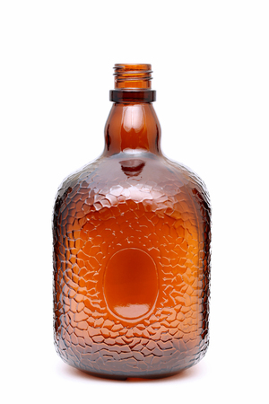whisky bottle: Brown glass bottle on a white background Stock Photo
