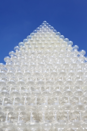 champagne glasses tower against clear blue sky photo