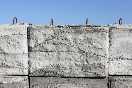 concrete weight against a blue sky