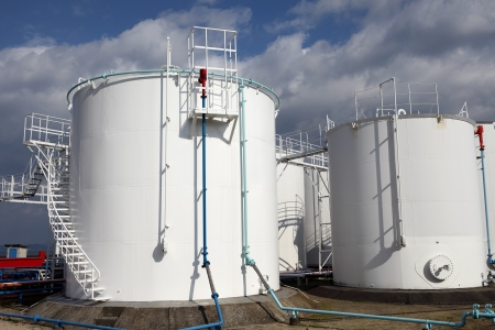 white storage tanks against the blue sky  Stok Fotoğraf