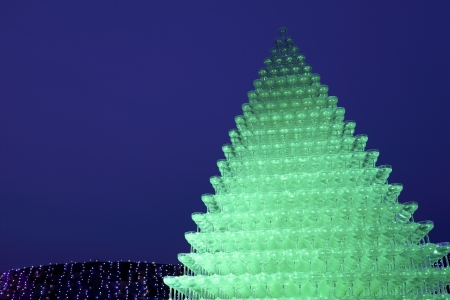 Illuminated champagne glass pyramid at night photo