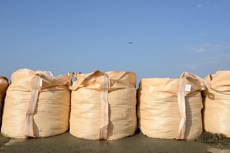 sandbag: big sandbags for protection against a blue sky