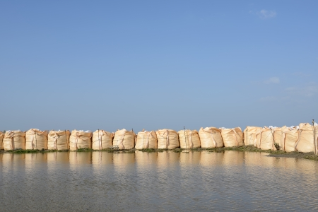 big sandbags for protection against a blue sky  photo