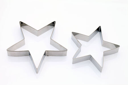 silver stars: Star shaped cookie cutter on white background