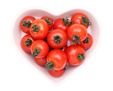 cherry tomatoes on heart-shaped plate photo