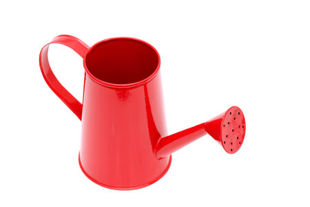 Closeup of the spout of a red watering can photo