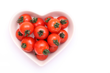 cherry tomatoes on heart shaped plate photo