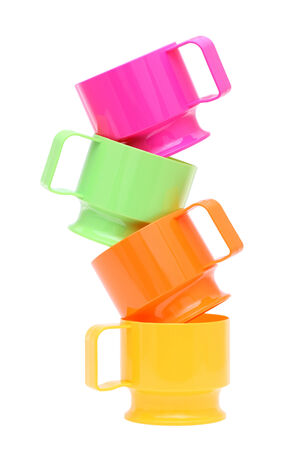 Stack of colorful plastic cups isolated on white background photo