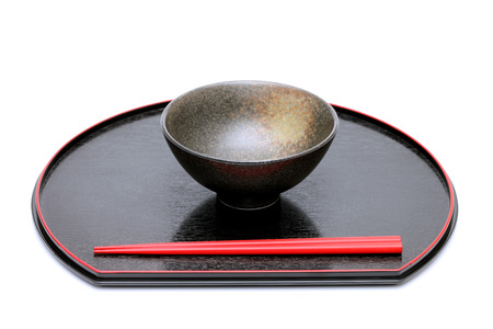 japanese rice bowl and chopsticks on wooden tray  photo