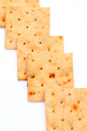 vegetable salty crackers on white background