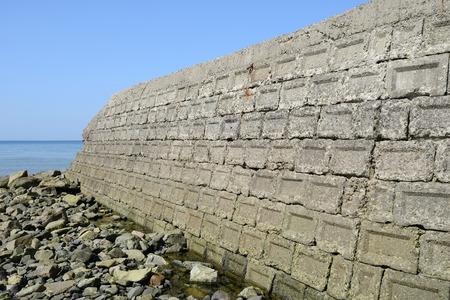 cornerstone: old concrete blocks against a blue sky