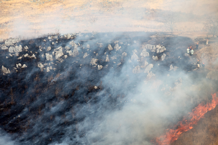 Landscape view of a burning land Stock Photo