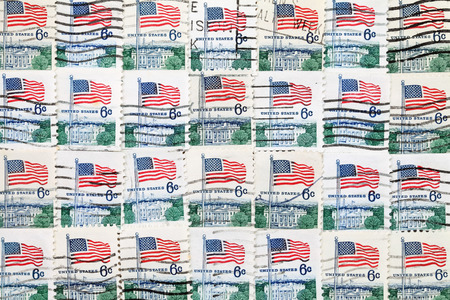 Background of used US postage stamps, close up